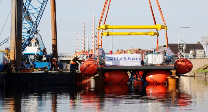 The bridge being placed in the water to be floated in using Unique Group's buoyancy bags