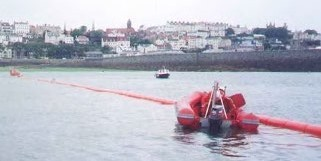 Small work boats are used to tow and position the cable